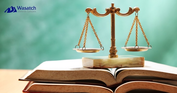 Scales of Justice on Books- Top-Rated Criminal Defense Lawyers