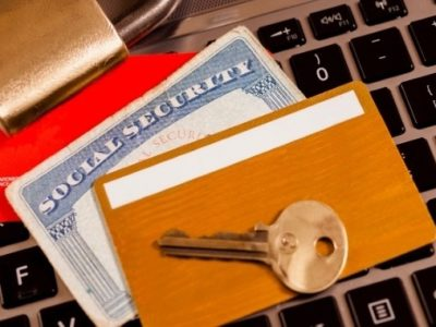 IDs, Social Security Card, Lock & Key on Keyboard