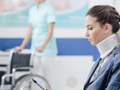 Woman with injured neck waiting in a hospital